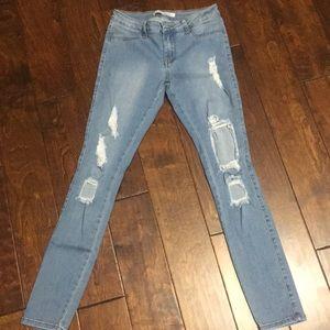 Light wash distressed jean